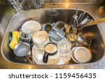dirty dishes in the kitchen... | Shutterstock . vector #1159456435