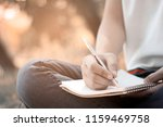 women siting and writing memory ... | Shutterstock . vector #1159469758