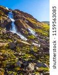 waterfall rushing from the... | Shutterstock . vector #1159563085