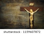 wood crucifix on a grunge wood... | Shutterstock . vector #1159607872