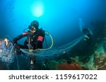 Scuba Divers Attempting To...
