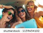 three female friends enjoying... | Shutterstock . vector #1159654102