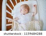 adorable baby girl sleeping in... | Shutterstock . vector #1159684288