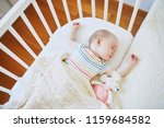 adorable baby girl sleeping in... | Shutterstock . vector #1159684582