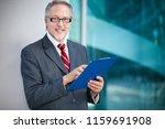 smiling mature business man... | Shutterstock . vector #1159691908