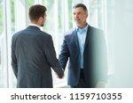 business people shaking hands ...   Shutterstock . vector #1159710355