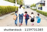 mother and four kids holding... | Shutterstock . vector #1159731385