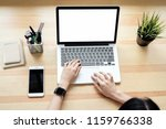 woman using laptop on table in... | Shutterstock . vector #1159766338