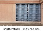 gray steel door on the concrete ... | Shutterstock . vector #1159766428