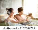 young couple relaxing in hot...   Shutterstock . vector #1159804795