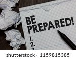 Small photo of Text sign showing Be Prepared. Conceptual photo Getting ready for whatever will happen Plan Ahead of time Marker over notebook crumpled papers ripped pages several tries mistakes.