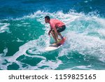 riding the waves. costa rica ... | Shutterstock . vector #1159825165
