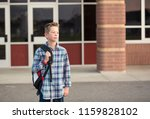 candid portrait of a male... | Shutterstock . vector #1159828102