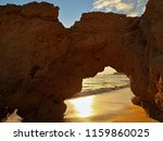a natural door in a cliff at a... | Shutterstock . vector #1159860025