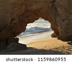a natural door in a cliff at a... | Shutterstock . vector #1159860955