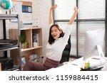 asian working women relaxed... | Shutterstock . vector #1159884415