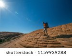 hiker on a trail in volcanic... | Shutterstock . vector #1159939288