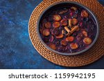oven baked plums with cinnamon... | Shutterstock . vector #1159942195