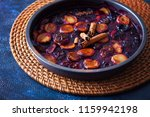 oven baked plums with cinnamon... | Shutterstock . vector #1159942198