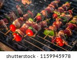 vegetables and meat kebabs... | Shutterstock . vector #1159945978