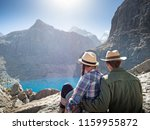 couple hiking in mountains | Shutterstock . vector #1159955872