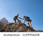 helping hand couple hikers in... | Shutterstock . vector #1159956658