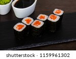 appetizing sushi with red... | Shutterstock . vector #1159961302