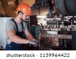 portrait of a young worker in a ... | Shutterstock . vector #1159964422