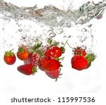 Strawberries Falling Into Wate...