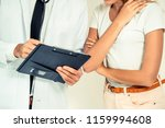 male doctor and female patient...   Shutterstock . vector #1159994608