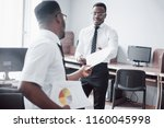 discussing a project. two black ...   Shutterstock . vector #1160045998