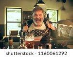 senior bearded man drinking...   Shutterstock . vector #1160061292