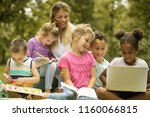 group of children with teacher... | Shutterstock . vector #1160066815