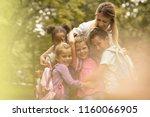 medium group of kids with... | Shutterstock . vector #1160066905