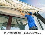 Worker Install An Awning On Th...