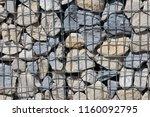 close up view of a steel gabion ... | Shutterstock . vector #1160092795