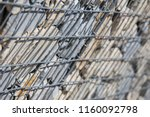 close up view of a steel gabion ... | Shutterstock . vector #1160092798