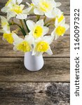 white daffodils at china vase... | Shutterstock . vector #1160097322