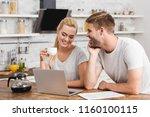 girlfriend holding cup of... | Shutterstock . vector #1160100115