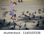 people and children are playing ... | Shutterstock . vector #1160105338