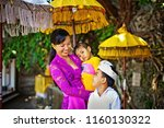 happy balinese mother... | Shutterstock . vector #1160130322