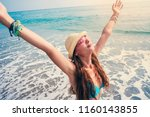 beautiful young woman on beach | Shutterstock . vector #1160143855