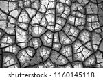 a brown  cracked earth...   Shutterstock . vector #1160145118