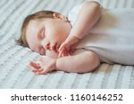 cute infant child sleeping on... | Shutterstock . vector #1160146252