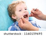 close up of boy having his... | Shutterstock . vector #1160159695
