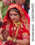 mathura  india   march 9  woman ... | Shutterstock . vector #1160186452