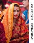 mathura  india   march 9  woman ... | Shutterstock . vector #1160186455