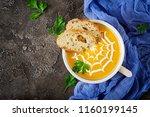 pumpkin soup in a bowl served... | Shutterstock . vector #1160199145