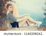 blonde with curly hair  ... | Shutterstock . vector #1160208262