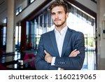 portrait of happy businessman... | Shutterstock . vector #1160219065